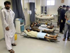 Victims of a suicide attack await treatment at a hospital in Kandahar.