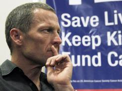 Among the supporters of Proposition 29 is cycling champion and cancer survivor Lance Armstrong, shown May 11 at a rally in Los Angeles.
