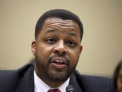 D.C. City Council Chairman Kwame Brown testifies on Capitol Hill in Washington. Brown was charged Wednesday with lying about his income on loan applications, becoming the second person on the panel in the last six months to face accusations of criminal wrongdoing.