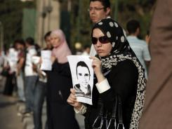 A woman holds a picture of Khaled Said on Wednesday during a protest marking the second anniversary of his death, allegedly at the hands of police in Cairo, Egypt.