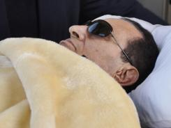 "The health of Hosni Mubarak entered a ""dangerous"" phase on Wednesday, officials said. Photo shows him being wheeled into court Jan. 29."