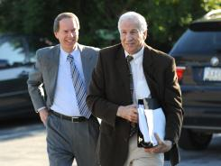 Jerry Sandusky, right, and his attorney Joe Amendola walk into the courthouse Wednesday for the second day of jury selection.