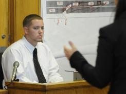 Defendant Aaron Deveau, 18, listens to assistant district attorney Ashlee Logan while testifying at Haverhill District Court in Haverhill, Mass., on Tuesday.