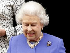 Britain's Queen Elizabeth II leaves King Edward VII hospital in London on Wednesday after visiting her husband, Prince Philip, who is admitted for a bladder infection.