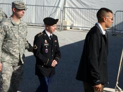 Army Private Bradley Manning, center, is escorted to military court on Wednesday in Fort Meade, Md.
