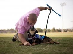 Retired Army major Jimmy LaCaria takes a break with service dog Kaeci, who helps him cope with his debilitating PTSD.