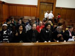 Nearly two dozen demonstrators arrested last year while protesting the New York Police Department's stop-and-frisk policy appear in criminal court in New York on April 30.