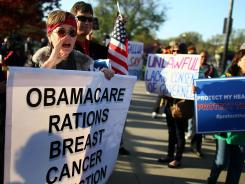 Linda Door protests against President Obama's health care plan in front of the U.S. Supreme Court building on March 26.