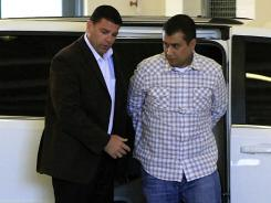 George Zimmerman, right, returns to the John E. Polk Correctional Facility in Sanford, Fla., on Sunday.