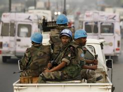 United Nations troops from Niger conduct a patrol through the streets of Abidjan, Ivory Coast, on Jan. 10, 2011.