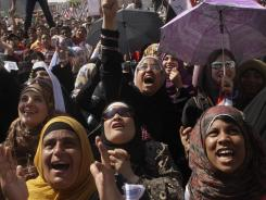 Egyptians shout slogans Friday in Cairo's Tahrir Square. Women in one area of square who were demanding an end to sexual harassment were attacked by a mob of men.