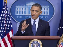 President Obama talks about the economy on Friday in the briefing room of the White House.