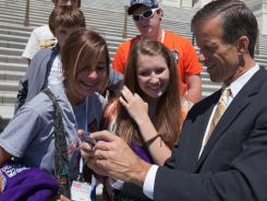 Sen. John Thune, R-S.D., speaks with high school students during their visit to the Capitol Thursday.