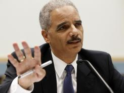 Attorney General Eric Holder testifies on Capitol Hill on Thursday, the day before naming two U.S. attorneys to probe information leaks.