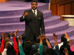 The Rev. Creflo Dollar, pictured in a 2007 photo, denied Sunday that he injured his daughter.
