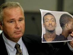 Auburn Police Chief Tommy Dawson holds up a photo of Desmonte Leonard, 22, of Montgomery, Ala., the suspect wanted for fatally shooting three people during a party at an apartment complex near the university.