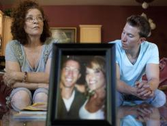 Pamela Blaies and Jonathan Blaies and a photo of Amanda Blaies-Rinaldi who was killed by her husband in 2011. Small photo is of Amanda and Jonathan, who are twins.