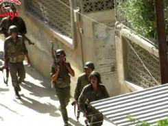 Image grab from a YouTube video on Saturday shows Syrian troops deploying in Duma, in a suburb of Damascus.
