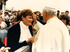 40th anniversary as sister: Pope John Paul prays with Sister Jeanne O'Laughlin in June 1985 at Vatican City.