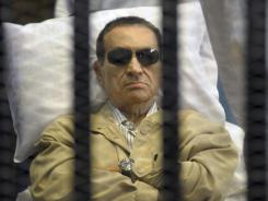 Egypt's ex-president Hosni Mubarak lies on a gurney in a Cairo courthouse June 2. His health has since deteriorated, officials say.