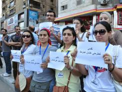 "As part of the Nefsi (Hope) campaign, young Egyptians hold up signs that read, ""I hope that you will respect me so that I may respect you."""