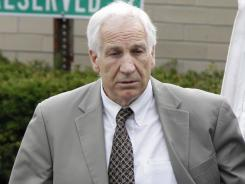 Former Penn State assistant football coach Jerry Sandusky leaves a courthouse in Bellefonte, Pa., after the first day of his trial Monday.