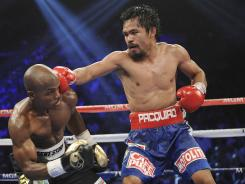Manny Pacquiao hits Timothy Bradley in a fight Saturday.