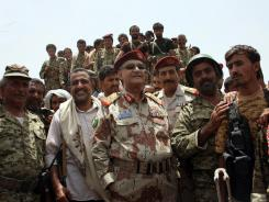 Yemeni Defense Minister General Mohammed Nasser Ahmed, center, who survived an assassination attempt, oversees a military operation against al-Qaeda in Loder, in the southern Abyan province, on Sunday.