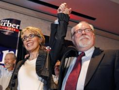 Ron Barber celebrates with Gabrielle Giffords in Tucson after winning Tuesday's special election to succeed her.