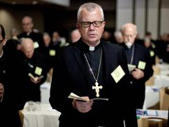 Auxiliary Bishop Donald Hying of the Archdiocese of Milwaukee Hying joins a prayer during the U.S. Conference of Catholic Bishops' biannual meeting Wednesday in Atlanta.