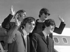 British invasion: The Beatles arrive in San Francisco in 1964 on their American tour.