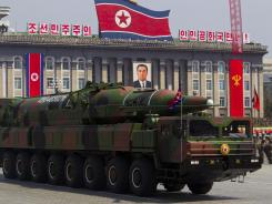 A North Korean vehicle carrying a missile passes by during a parade in Pyongyang's Kim Il Sung Square on April 15.