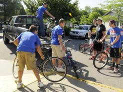 Students load bikes into a truck during an organized ride last month to Kenowa Hills High School in Walker, Mich. The 65 graduating seniors who participated were suspended for violating a no-pranks rule