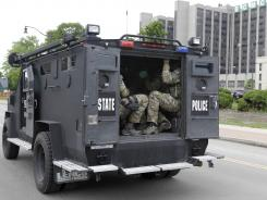 SWAT officers arrive Wednesday at the scene of a shooting at Erie Count Medical Center in Buffalo, N.Y