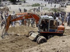 Afghan officials say they are halting efforts to dig out scores of bodies from the site of a devastating landslide that followed earthquakes in northern Afghanistan on Monday.