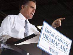 Romney: Making a point in Orlando on Tuesday.