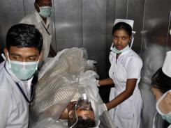 An injured employee of a steel plant is being rushed to a hospital in Visakhapatnam, India, on Wednesday.
