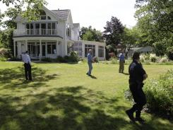 Law enforcement officers search Dr. Timothy Jorden's home in Hamburg, N.Y., on Thursday.