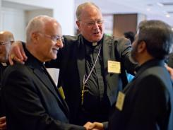 New York Archbishop Timothy Dolan, center, heads the U.S. Conference of Catholic Bishops.