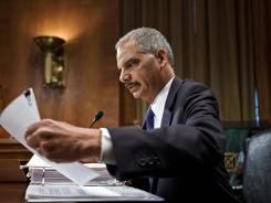 Attorney General Eric Holder prepares to testify on Capitol Hill Wednesday.