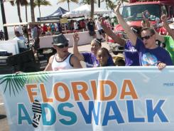 Participants at the 2012 Florida AIDS Walk &amp; Music Festival, sponsored by the &quot;AIDS Healthcare Foundation,&quot; at Fort Lauderdale's South Beach Park in May.