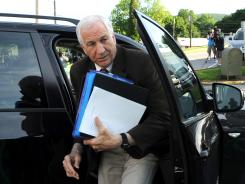 Jerry Sandusky arrives for the fourth day of his trial at the Centre County Courthouse in Bellefonte, Pa.
