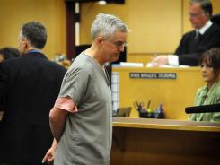 Steven Powell leaves the courtroom of Judge Ronald Culpepper after appearing in the Pierce County Superior Court.
