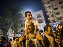 Protestors gather to protest against Egyptian presidential candidate Ahmed Shafiq in Tahrir Square on Friday.