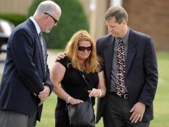 Mourners grieve after the funeral service of Jacqueline Wisniewski at St. Martin of Tours Church in Buffalo, N.Y.