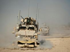 An MRAP truck clears the road near Kandahar, Afghanistan.