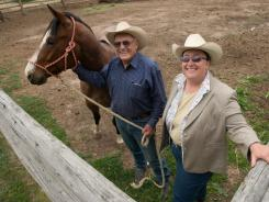 Wyoming state Rep. Sue Wallis, R, shown here with her father Dick, wants to open horse-slaughter plants in several states.