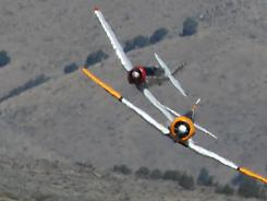 Two T-6s race through heat waves Friday at Reno Stead Airport.