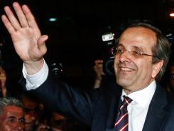 New Democracy Party leader Antonis Samaras waves at supporters near the Greek Parliament.