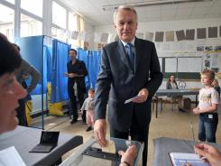 Jean-Marc Ayrault, France's Prime Minister and Socialist Party (PS) candidate in the 3rd constituency of the Loire-Atlantique, casts his ballot for the second round of the French parliamentary elections on Sunday.